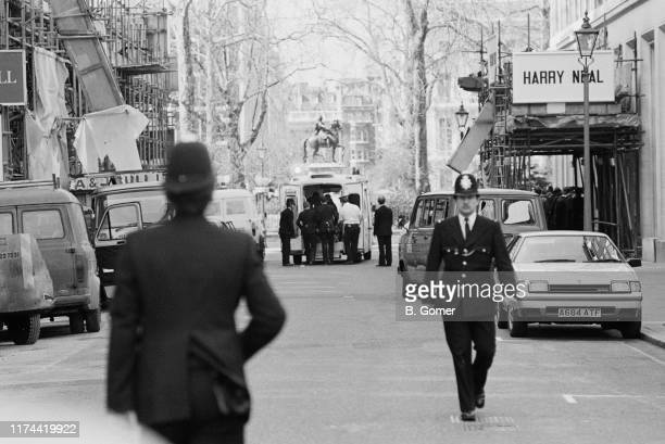 Police and an ambulance in Charles II Street after an unknown gunman opened fire on a demonstration against Libyan leader, Muammar Gaddafi outside...