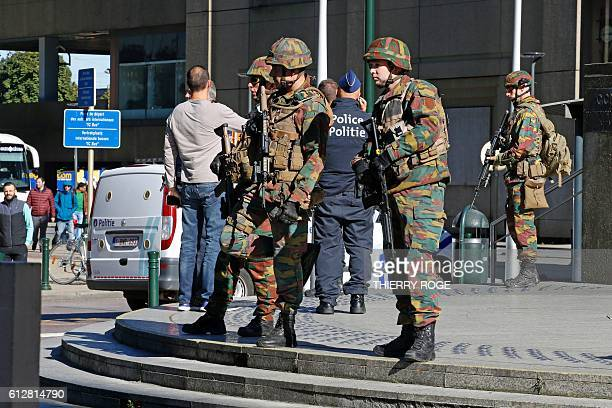 Police and army personnel stand guard during a bomb alert outside the BrusselsNorth train station in Brussels on October 5 2016 A bomb alarm was...