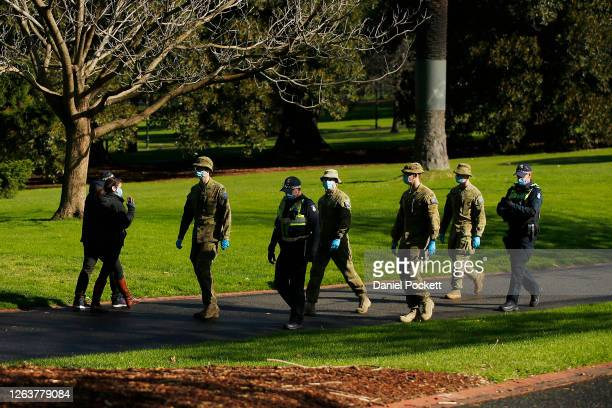 Police and Australian Defence Force patrols are seen in the Fitzroy Gardens on August 04, 2020 in Melbourne, Australia. Retail stores across...