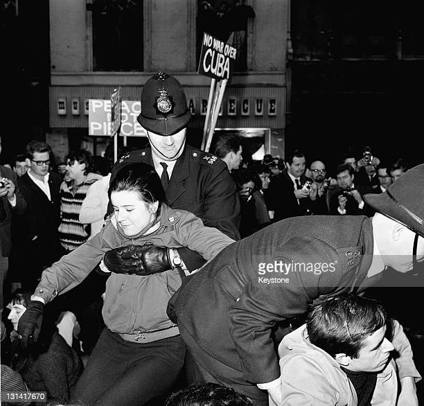 Police and CND demonstrators on Whitehall, London, during a protest against the United States' handling of the Cuban missile crisis, Whitehall,...