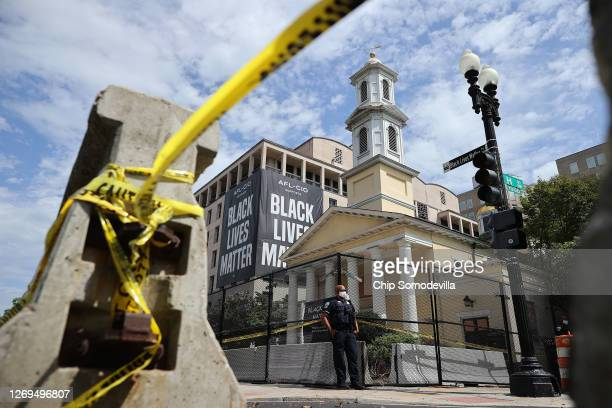 Police and concrete barricades surround St. John's Episcopal Church near Lafayette Square during the March on Washington August 28, 2020 in...