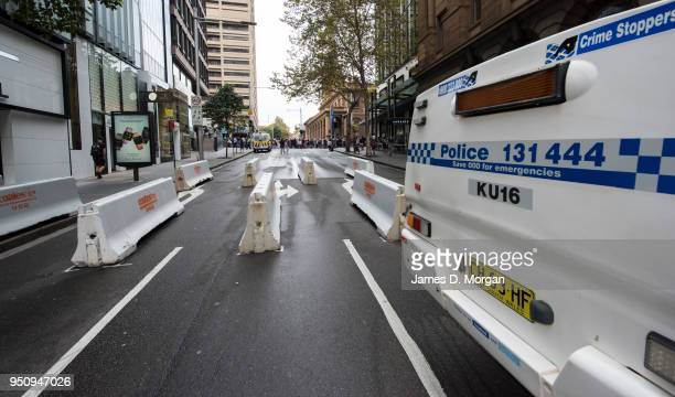 Police and concrete bollards protect thousands of participants in the Anzac Day march on April 25 2018 in Sydney Australia Australians commemorating...
