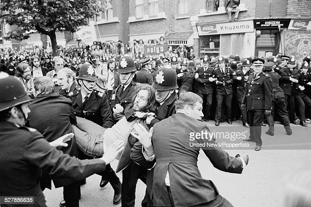 Police and demonstators clash in a residential street following picketing action by union members of the Grunwick film processing factory in...