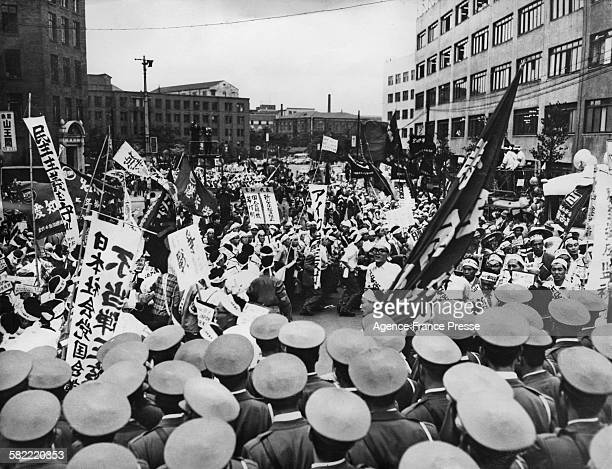 Police and demonstrators outside the American Embassy in Tokyo Japan June 1960 AntiAmerican protestors have gathered to demonstrate against the...