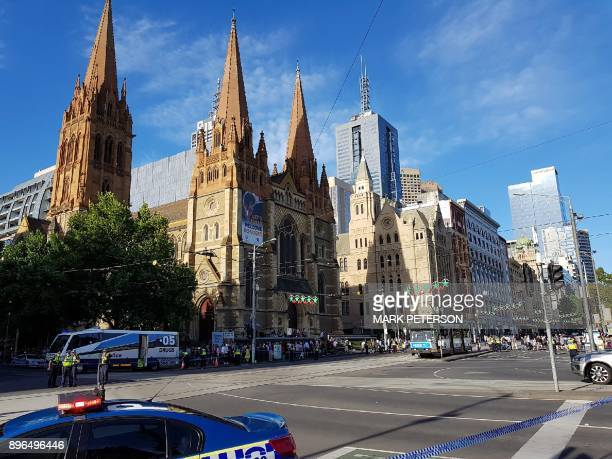 Police and emergency personnel cordon off the street as they work at the scene of where a car ran over pedestrians in Flinders Street in Melbourne on...