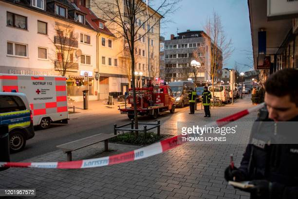 Police and emergency service are seen behind a police cordon near a bar and shisha bar in the centre of Hanau near Frankfurt am Main western Germany...