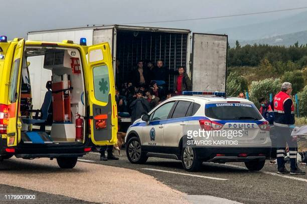 TOPSHOT Police and emergency services are at work it take care of 41 migrants who were found alive in a refrigerated truck near Xanthi northern...