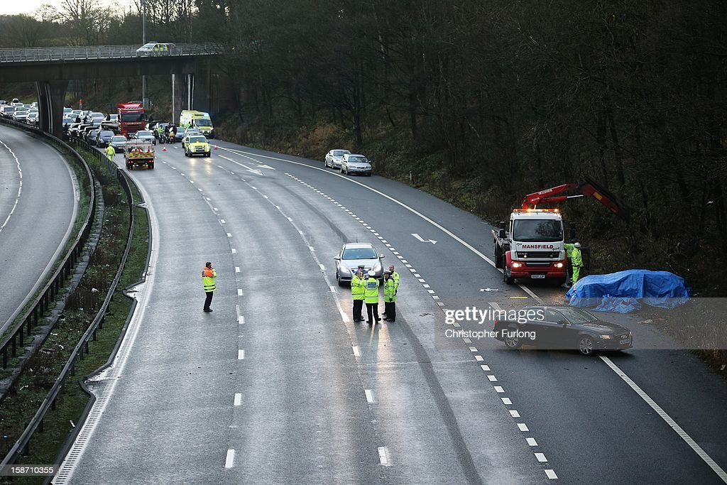 Police and emergency services attend the aftermath of a serious motor accident between Junctions 14 and 15 on the M6 motorway on December 25, 2012 between Stafford and Stoke-on-Trent, England. West Midlands Ambulance service are reporting that three children died in the accident and two women are left critically injured.