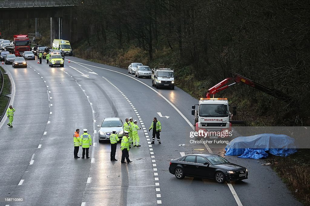 Police and emergency services attend the aftermath of a serious motor accident between Junctions 14 and 15 on the M6 motorway on December 25, 2012 between Stafford and Stoke-on-Trent, England. West Midlands Ambulance service are reporting that three children died in the accident and two women are left seriously injured.