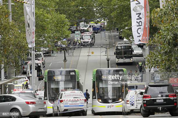 Police and emergency services vehicles block off Bourke street on January 20 2017 in Melbourne Australia Three people have been killed and 20 are...