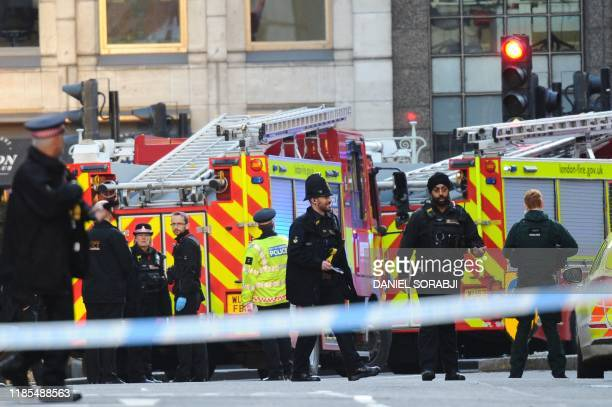 Police and emergency vechiles gather near London Bridge in London on November 29 2019 after reports of shots being fired on London Bridge A man...
