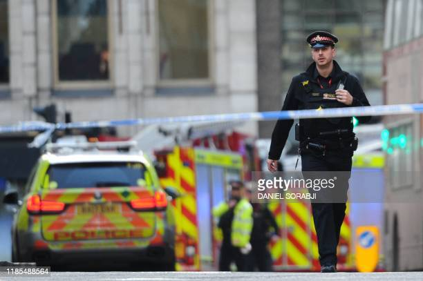 Police and emergency vechiles gather near London Bridge in London, on November 29, 2019 after reports of shots being fired on London Bridge. - A man...