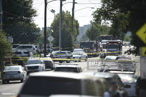 Police and emergency vehicles are seen at the scene of an early morning shooting in Alexandria Virginia June 14 2017 Senior Republican Congressman...