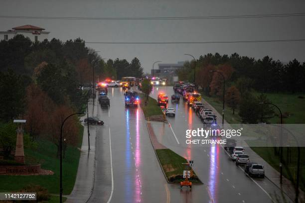 Police and emergency vehicles are seen on a street near the STEM School Highlands Ranch after a shooting at the school in Highlands Ranch on May 7...