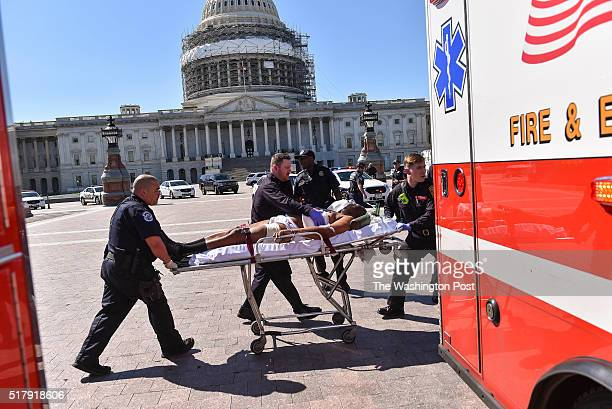 Suspect's face was slightly obscured digitally at the request of DC Fire and EMS Department** WASHINGTON DC MARCH 28 2016 Police and EMS personnel...