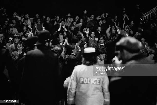 """Police and fans during the """"Luton Riot"""", which happened during Luton Town and Millwall FA Cup match at Kenilworth Road ground, Luton, UK, 13th March..."""
