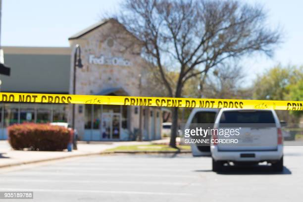 Police and FBI Agents investigate at the Sunset Valley FedEx store located on Brodie Lane in Austin Texas which is linked to the package bomb which...