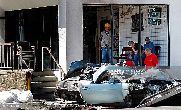 Police and fire personnel clear the wreckage of a late model BMW that crashed into a Studio City Pizza parlor leaving three people dead on SEPTEMBER...