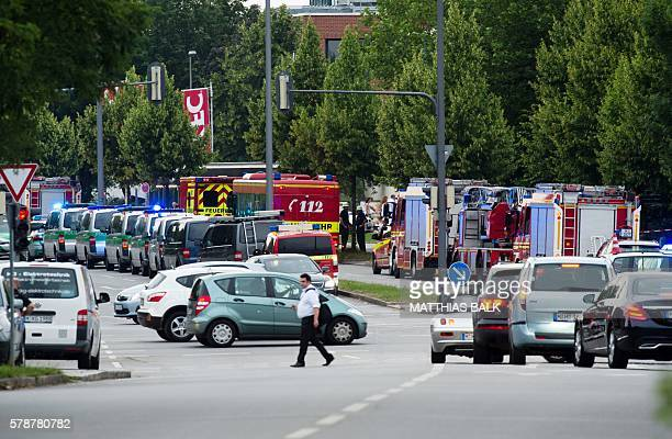 Police and firefighters are seen near a shopping mall amid a shooting on July 22 2016 in Munich Several people were killed on Friday in a shooting...