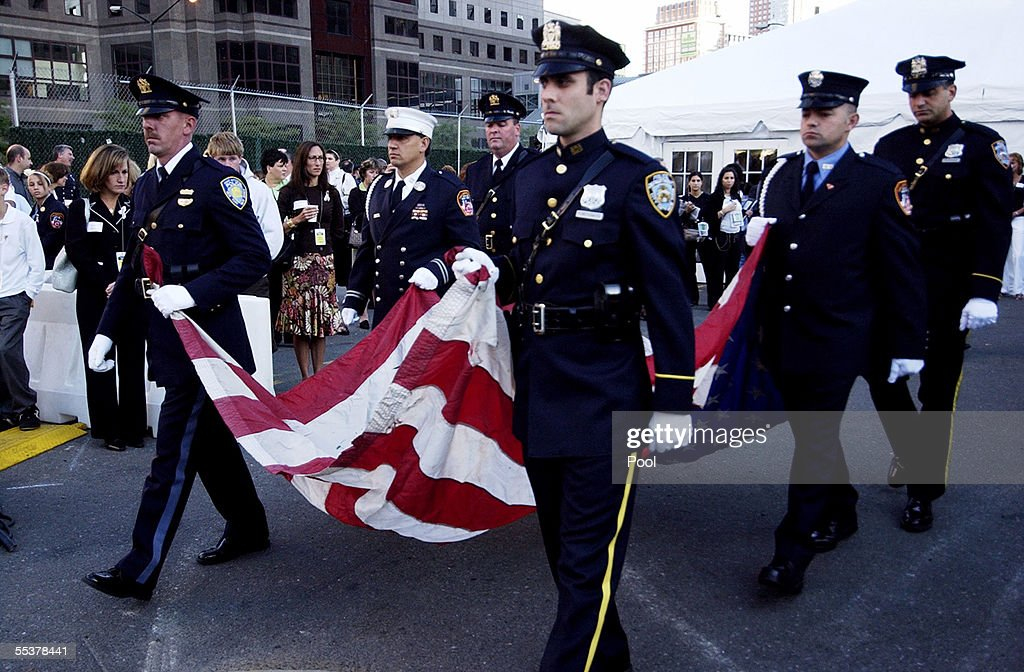 Police and firefighters carry the U.S. flag that once flew over Ground Zero until late October of 2001 during a ceremony September 11, 2005 in New York City. This is the fourth anniversary commemoration of the September 11, 2001 attacks.