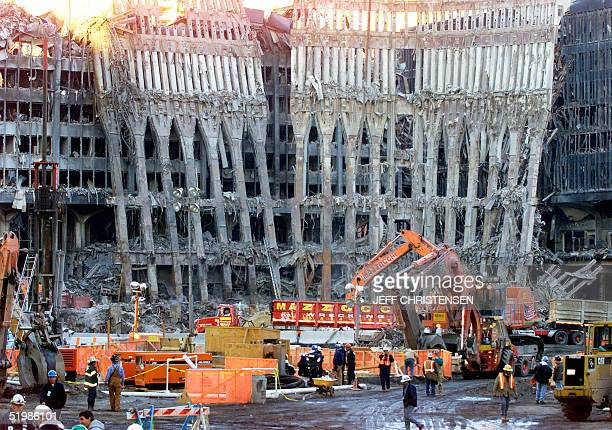 Police and firefigthers work amid the rubble of the destroyed World Trade Center 09 November 2001 in New York. At Ground Zero -- where the twin World...