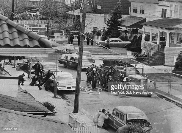 Police and firemen take cover behind vehicles as they try to flush out Sylvester Lally. In a family dispute, Lally shot and seriously wounded his...