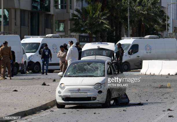 Police and forensic experts gather at the scene of an explosion near the US embassy in the Tunisian capital Tunis on March 6 2020 A blast that rocked...