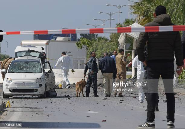 Police and forensic experts inspect the scene of an explosion near the US embassy in the Tunisian capital Tunis on March 6 2020 A double suicide...