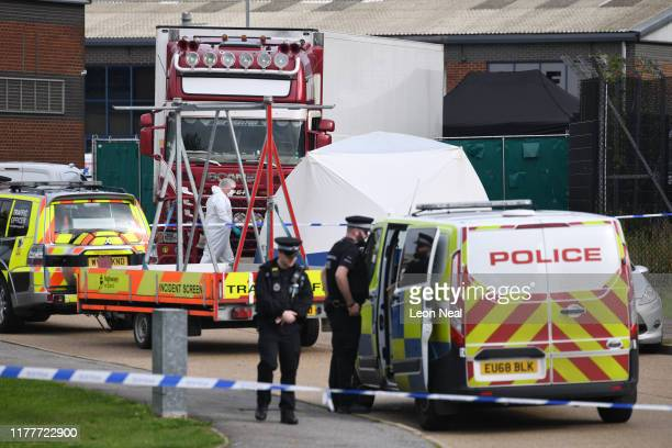 Police and forensic officers inspect the site where 39 bodies were discovered in the back of a lorry on October 23, 2019 in Thurrock, England. The...