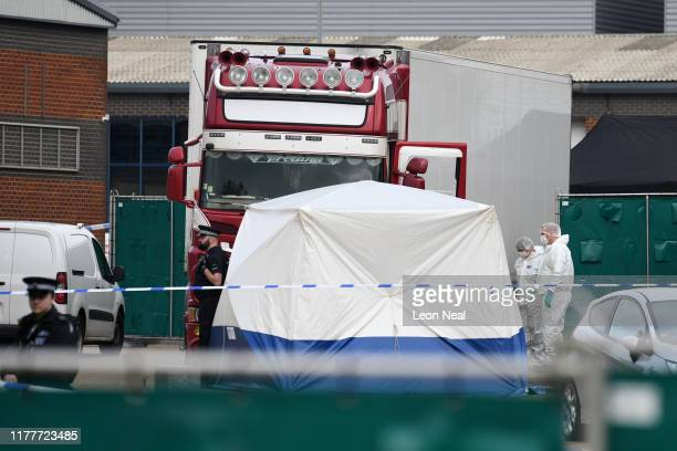 Police and forensic officers investigate the site where 39 bodies were discovered in the back of a lorry on October 23, 2019 in Thurrock, England....