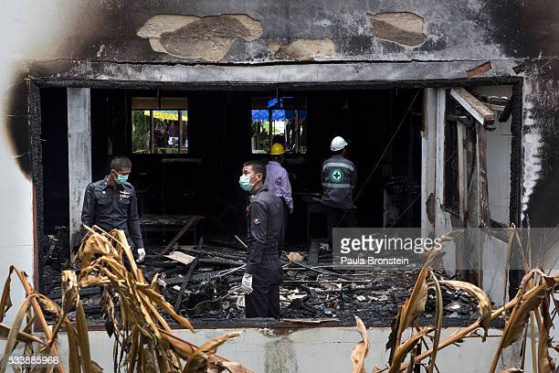 Police and forensic officials inspect the school dormitory where a fire broke out on Sunday night killing at least 17 girls on May 24 2016 in Wiang...
