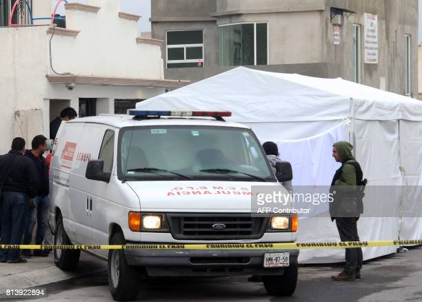 Police and forensic personnel work on a crime scene where attackers burst during a party and murdered 11 people in Tizayuca Hidalgo state Mexico on...