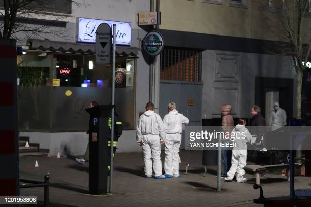 Police and Forensic police investigate the scene of a shooting in Hanau western Germany on February 20 2020 At least eight people were killed in two...