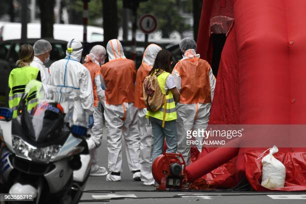 Police and forensic police officers work on the scene of a shooting in Liege Belgium after a gunman on May 29 2018 shot dead two female police...