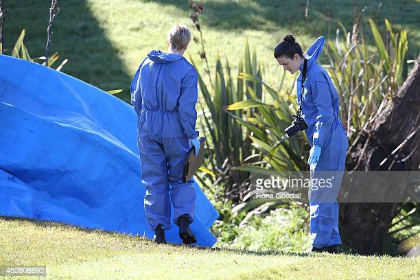 Police and forensic staff examine the scene at Maybury Reserve on July 28 2014 in Auckland New Zealand A 13 year old girl was allegedly sexually...