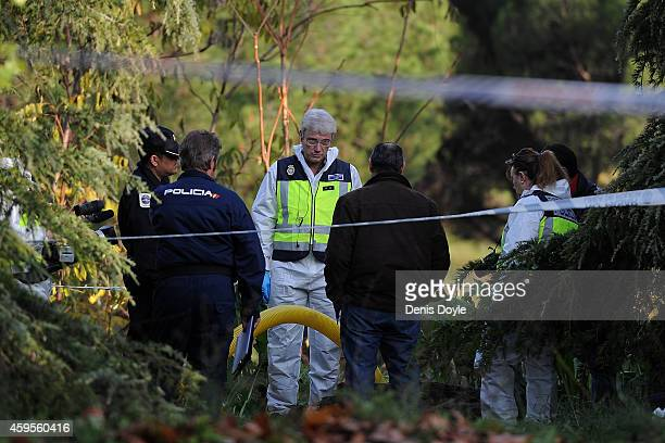 Police and forensics officers search a drain in Dehesa de la Villa park after the June 30th disappearance of Adolfina Puello 30 and her 9 year old...