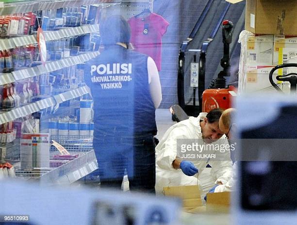 Police and foresics work at the scene where four people were shot dead in the Prisma supermarket of the Sello shopping center in Espoo Finland on...