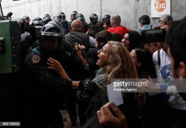 Police and gendarmerie crew intervene the voters in the Catalan independence referendum at a sport hall where Catalan President Carles Puigdemont...