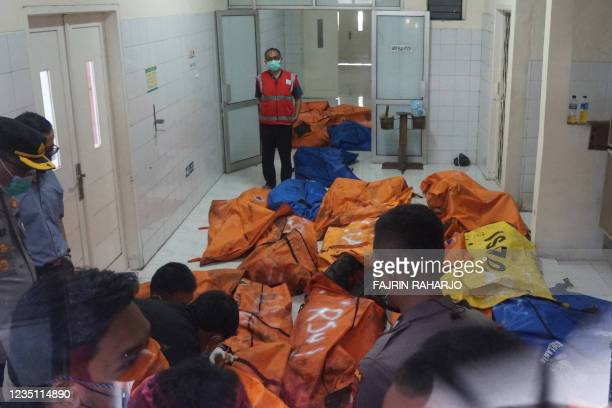 Police and hospital officials store body bags of dead victims at a morgue in a local general hospital in Tangerang on September 8 after a prison fire...