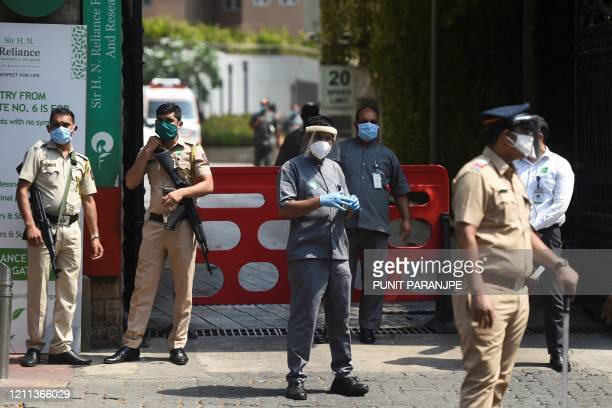 Police and hospital security personnel guard an entrance of the HN Reliance Foundation hospital where Bollywood actor Rishi Kapoor was admitted in...