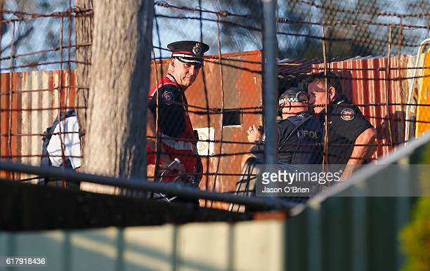 Police and investigators at Dreamworld on October 25 2016 in Gold Coast Australia Four people have been confirmed dead following an accident on the...