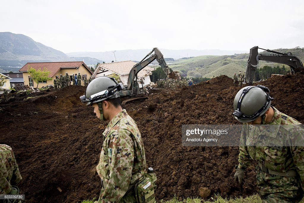 Police and Japan Ground Self-Defense Force continue to find missing bodies on April 18, 2016 in Minamiaso, Kumamoto, Japan. After the magnitude 7.3 earthquake hit Kyushu at least 42 people have died and 11 still missing.