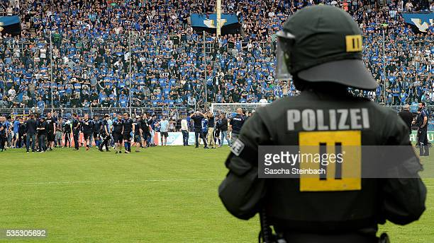 Police and Mannheim supporters face each other on the pitch after the 3 Liga playoff leg 2 match between Waldhof Mannheim and Sportfreunde Lotte at...