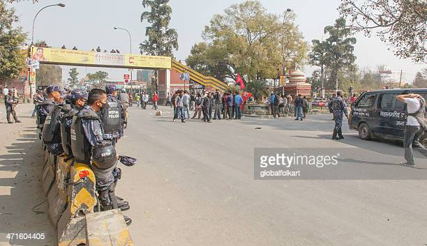 police and maoists facing off during general strike - nepalese army stock pictures, royalty-free photos & images