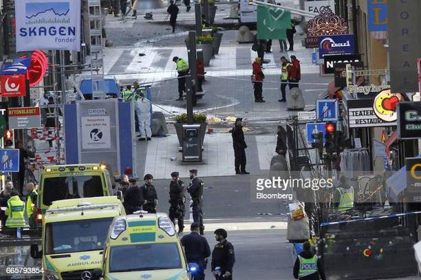 Police and medical services respond to an emergency on Drottninggatan street following a truck driving into the Ahlens department store in Stockholm...