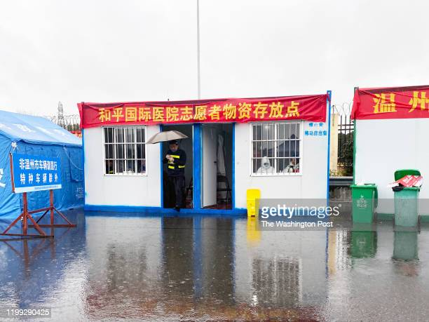 Police and medical staff are working at the southern entry gate to Wenzhou the Chinese city with the most coronavirus infections outside Hubei...
