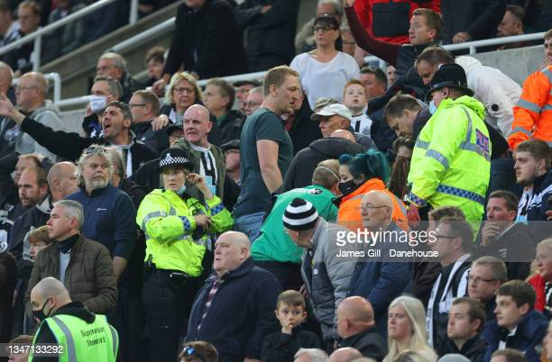 Police and medical staff react to a medical emergency occurring in the stand with a supporter during the Premier League match between Newcastle...