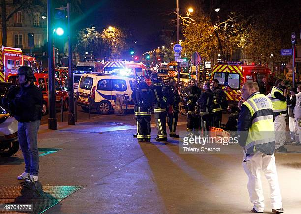 Police and medics gather near the Boulevard des FillesduCalvaire after an attack November 13 2015 in Paris France Gunfire and explosions in multiple...
