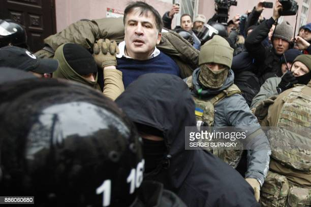 Police and members of Ukrainian security services detain former Georgian president Mikheil Saakashvili in downtown Kiev on December 5 2017 Ukrainian...