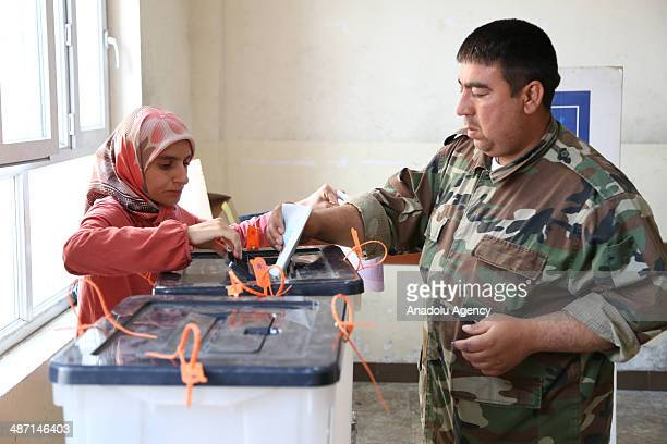 Police and military personnel vote in Iraq's pivotal parliamentary elections on April 27 2014 in Irbil Iraq Iraqi people will go to the polls on...